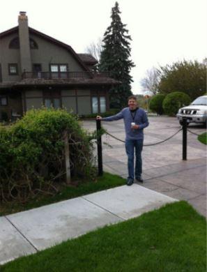 Greg at his home