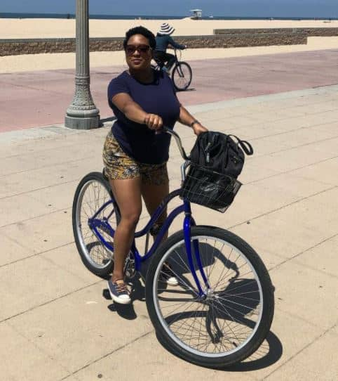 Channelle riding her bike to her home