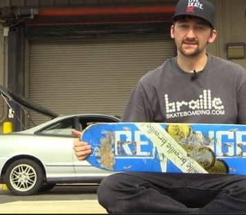Aaron Kyro infront of his car